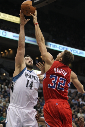 Nov 20, 2013; Minneapolis, MN, USA; Minnesota Timberwolves center Nikola Pekovic (14) gets his shot blocked by Los Angeles Clippers forward Blake Griffin (32) during the third quarter at Target Center. The Clippers defeated the Timberwolves 102-98. Mandatory Credit: Brace Hemmelgarn-USA TODAY Sports