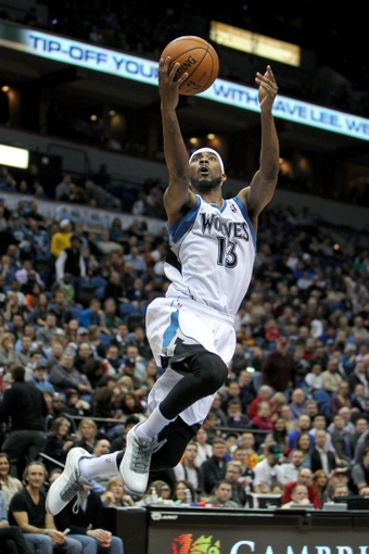 Nov 20, 2013; Minneapolis, MN, USA; Minnesota Timberwolves forward Corey Brewer (13) shoots during the third quarter against the Los Angeles Clippers at Target Center. The Clippers defeated the Timberwolves 102-98. Mandatory Credit: Brace Hemmelgarn-USA TODAY Sports