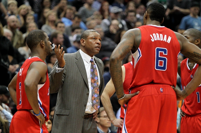 Nov 20, 2013; Minneapolis, MN, USA; Los Angeles Clippers head coach Doc Rivers talks to his team during the fourth quarter against the Minnesota Timberwolves at Target Center. The Clippers defeated the Timberwolves 102-98. Mandatory Credit: Brace Hemmelgarn-USA TODAY Sports