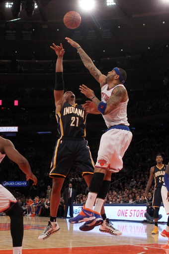 Nov 20, 2013; New York, NY, USA; New York Knicks power forward Kenyon Martin (3) blocks a shot by Indiana Pacers power forward David West (21) during the third quarter at Madison Square Garden. The Pacers defeated the Knicks 103-96 in overtime. Mandatory Credit: Brad Penner-USA TODAY Sports