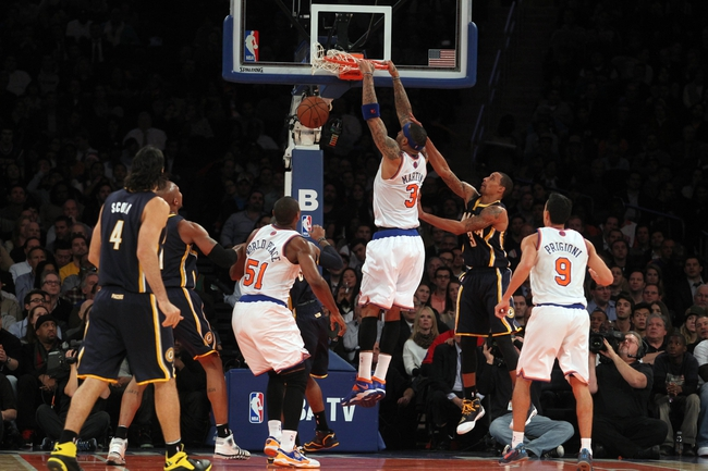 Nov 20, 2013; New York, NY, USA; New York Knicks power forward Kenyon Martin (3) dunks past Indiana Pacers point guard George Hill (3) during the third quarter at Madison Square Garden. The Pacers defeated the Knicks 103-96 in overtime. Mandatory Credit: Brad Penner-USA TODAY Sports