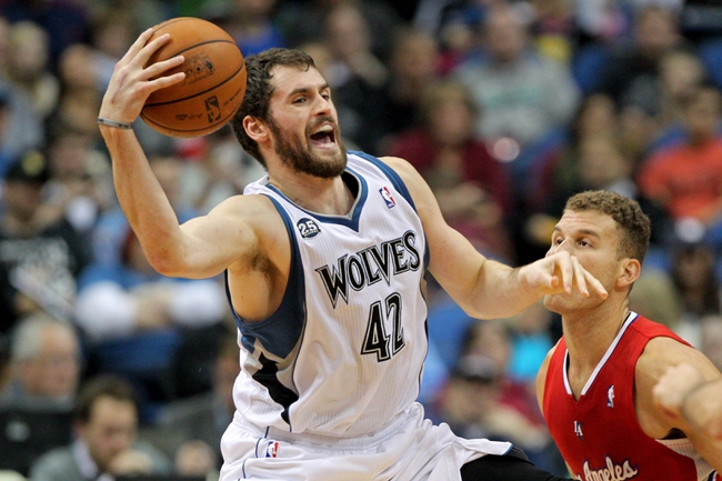 Nov 20, 2013; Minneapolis, MN, USA; Minnesota Timberwolves forward Kevin Love (42) grabs a loose ball during the second quarter against the Los Angeles Clippers at Target Center. The Clippers defeated the Timberwolves 102-98. Mandatory Credit: Brace Hemmelgarn-USA TODAY Sports