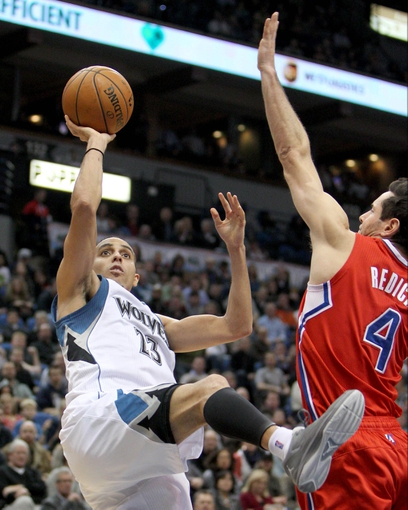 Nov 20, 2013; Minneapolis, MN, USA; Minnesota Timberwolves guard Kevin Martin (23) shoots over Los Angeles Clippers guard J.J. Redick (4) during the fourth quarter at Target Center. The Clippers defeated the Timberwolves 102-98. Mandatory Credit: Brace Hemmelgarn-USA TODAY Sports