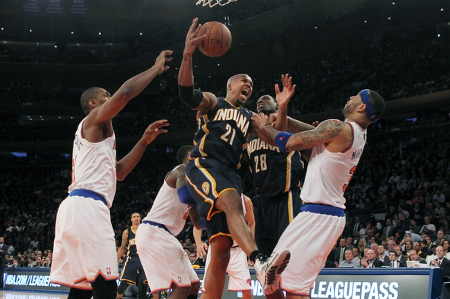 Nov 20, 2013; New York, NY, USA; Indiana Pacers power forward David West (21) reacts after shooting a basket against the New York Knicks during the third quarter at Madison Square Garden. The Pacers defeated the Knicks 103-96 in overtime. Mandatory Credit: Brad Penner-USA TODAY Sports