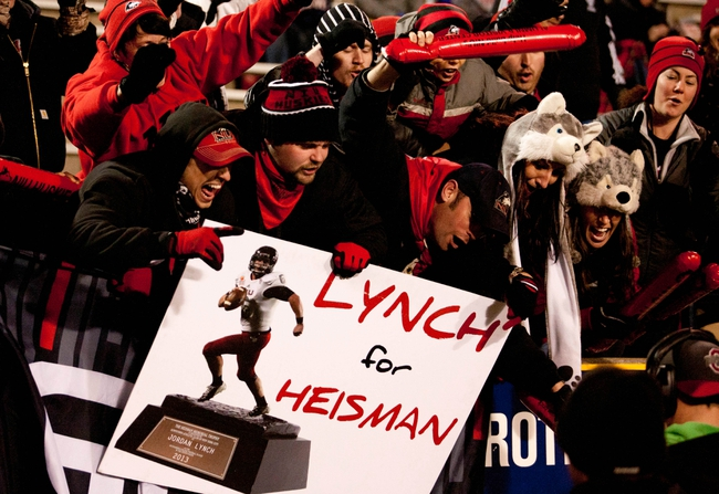 Nov 20, 2013; Toledo, OH, USA; Northern Illinois Huskies fans hold up a sign for quarterback Jordan Lynch (6) during the fourth quarter against the Toledo Rockets at Glass Bowl. The Huskies beat the Rockets 35-17. Mandatory Credit: Raj Mehta-USA TODAY Sports