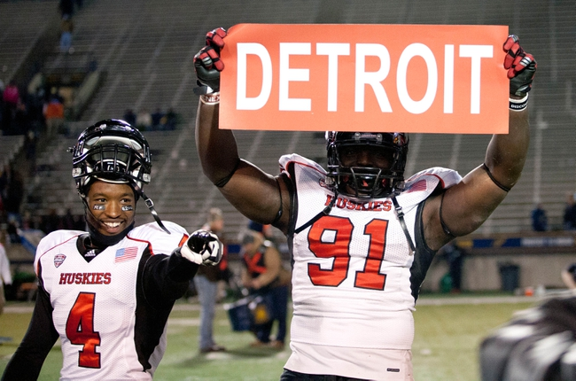 Nov 20, 2013; Toledo, OH, USA; Northern Illinois Huskies defensive tackle Anthony Wells (91) holds up a Detroit sign after the game with wide receiver Da'Ron Brown (4) at Glass Bowl. The Huskies beat the Rockets 35-17. Mandatory Credit: Raj Mehta-USA TODAY Sports
