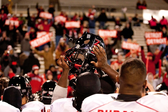 Nov 20, 2013; Toledo, OH, USA; Northern Illinois Huskies players and fans celebrate together after the game against the Toledo Rockets at Glass Bowl. The Huskies beat the Rockets 35-17. Mandatory Credit: Raj Mehta-USA TODAY Sports