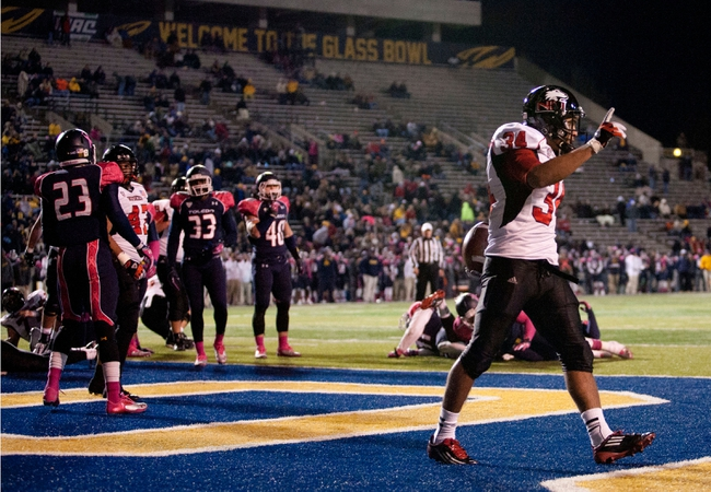 Nov 20, 2013; Toledo, OH, USA; Northern Illinois Huskies running back James Spencer (34) celebrates after a touchdown run during the fourth quarter against the Toledo Rockets at Glass Bowl. The Huskies beat the Rockets 35-17. Mandatory Credit: Raj Mehta-USA TODAY Sports
