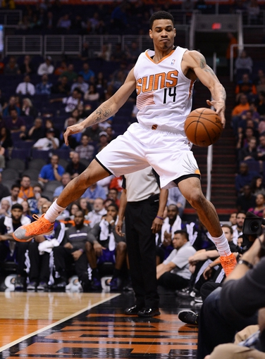 Nov 20, 2013; Phoenix, AZ, USA; Phoenix Suns guard Gerald Green (14) jumps to save the ball from going out of bounds against the Sacramento Kings in the second half at US Airways Center. The Kings defeated the Suns 113-106. Mandatory Credit: Jennifer Stewart-USA TODAY Sports