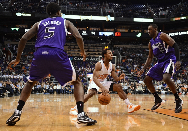 Nov 20, 2013; Phoenix, AZ, USA; Phoenix Suns guard Ish Smith (3) handles the ball against the Sacramento Kings forward John Salmons (5) and forward Patrick Patterson (9) in the second half at US Airways Center. The Kings defeated the Suns 113-106. Mandatory Credit: Jennifer Stewart-USA TODAY Sports