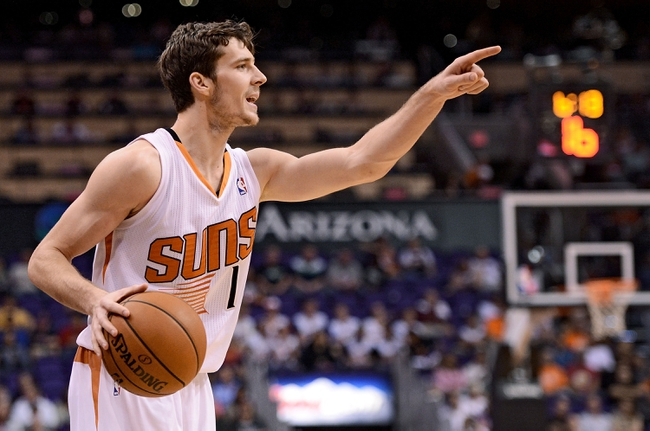 Nov 20, 2013; Phoenix, AZ, USA; Phoenix Suns guard Goran Dragic (1) gestures as he handles the ball in the second half of the game against the Sacramento Kings at US Airways Center. The Kings defeated the Suns 113-106. Mandatory Credit: Jennifer Stewart-USA TODAY Sports