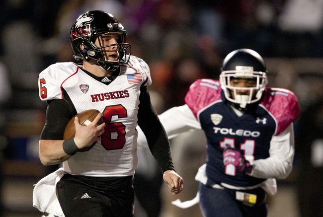 Nov 20, 2013; Toledo, OH, USA; Northern Illinois Huskies quarterback Jordan Lynch (6) runs the ball as Toledo Rockets defensive back Cheatham Norrils (11) chases during the third quarter at Glass Bowl. The Huskies beat the Rockets 35-17. Mandatory Credit: Raj Mehta-USA TODAY Sports