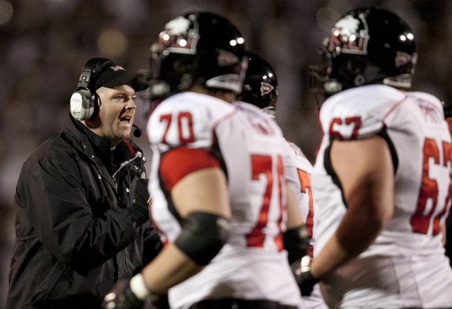 Nov 20, 2013; Toledo, OH, USA; Northern Illinois Huskies head coach Rod Carey greets his players as they run off the field during the third quarter against the Toledo Rockets at Glass Bowl. The Huskies beat the Rockets 35-17. Mandatory Credit: Raj Mehta-USA TODAY Sports