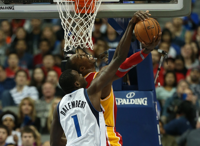 Nov 20, 2013; Dallas, TX, USA; Houston Rockets center Dwight Howard (12) has his shot blocked by Dallas Mavericks center Samuel Dalembert (1) in the fourth quarter at American Airlines Center. Mandatory Credit: Matthew Emmons-USA TODAY Sports