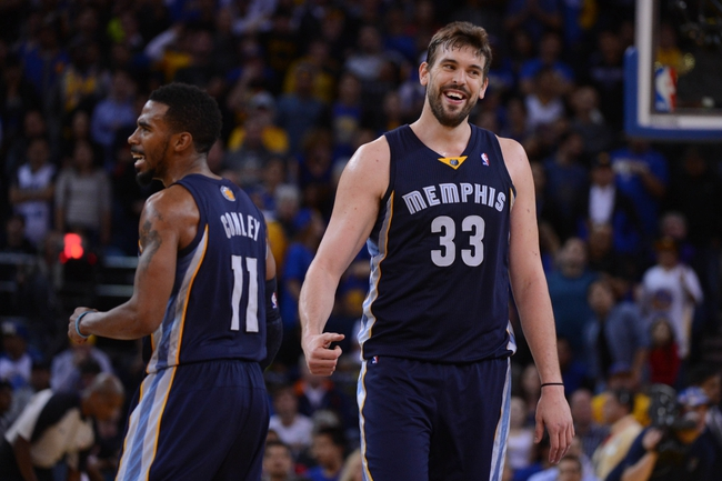 November 20, 2013; Oakland, CA, USA; Memphis Grizzlies point guard Mike Conley (11) and center Marc Gasol (33) celebrate after a basket during overtime against the Golden State Warriors at Oracle Arena. The Grizzlies defeated the Warriors 88-81 in overtime. Mandatory Credit: Kyle Terada-USA TODAY Sports