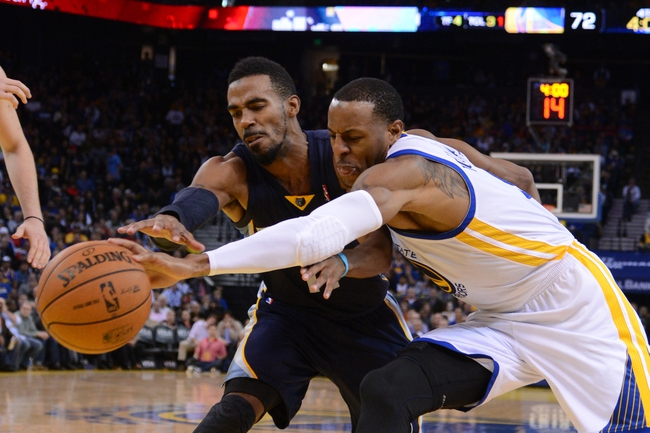 November 20, 2013; Oakland, CA, USA; Memphis Grizzlies point guard Mike Conley (11, left) and Golden State Warriors small forward Andre Iguodala (9, right) fight for the ball during the fourth quarter at Oracle Arena. The Grizzlies defeated the Warriors 88-81 in overtime. Mandatory Credit: Kyle Terada-USA TODAY Sports