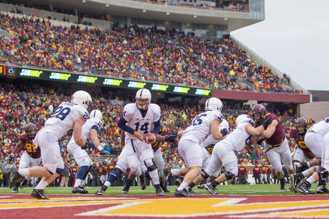 Nov 9, 2013; Minneapolis, MN, USA; Penn State Nittany Lions quarterback Christian Hackenberg (14) hands the ball off to running back Zach Zwinak (28) in the fourth quarter against the Minnesota Gophers at TCF Bank Stadium. Minnesota wins 24-10. Mandatory Credit: Brad Rempel-USA TODAY Sports