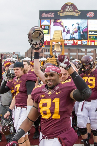 Nov 9, 2013; Minneapolis, MN, USA; Minnesota Gophers tight end Duke Anyanwu (81) celebrates the win against Penn State Nittany Lions at TCF Bank Stadium. Minnesota wins 24-10. Mandatory Credit: Brad Rempel-USA TODAY Sports