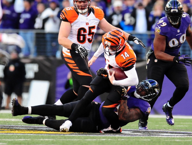 Nov 10, 2013; Baltimore, MD, USA; Cincinnati Bengals quarterback Andy Dalton (14) is tackled by Baltimore Ravens linebacker Terrell Suggs (55) at M&T Bank Stadium. Mandatory Credit: Evan Habeeb-USA TODAY Sports