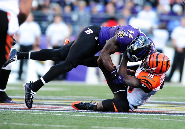 Nov 10, 2013; Baltimore, MD, USA; Cincinnati Bengals wide receiver A.J. Green (18) is tackled by Baltimore Ravens safety James Ihedigbo (32) at M&T Bank Stadium. Mandatory Credit: Evan Habeeb-USA TODAY Sports