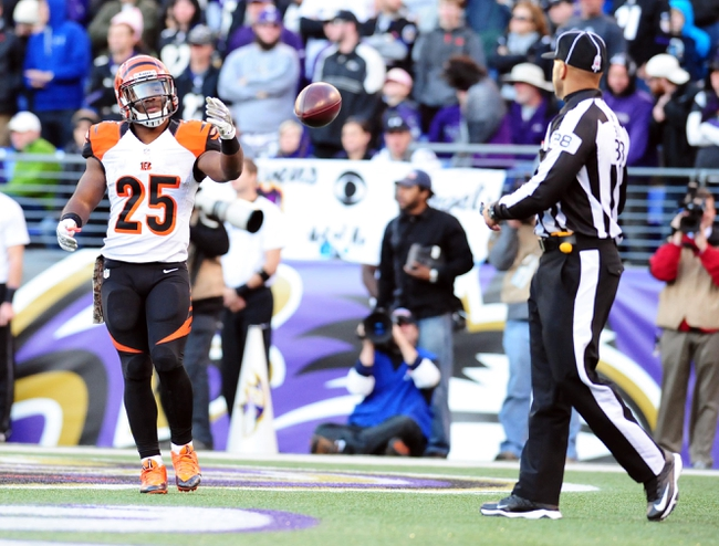 Nov 10, 2013; Baltimore, MD, USA; Cincinnati Bengals running back Giovani Bernard (25) tosses the ball to the official after scoring a touchdown during the game against the Baltimore Ravens at M&T Bank Stadium. Mandatory Credit: Evan Habeeb-USA TODAY Sports