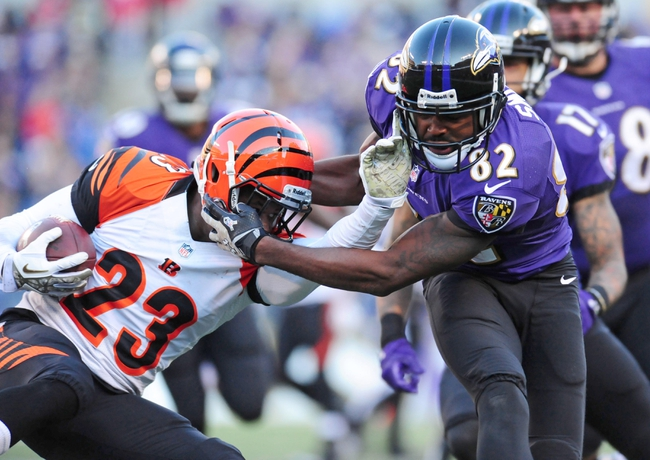 Nov 10, 2013; Baltimore, MD, USA; Cincinnati Bengals cornerback Terence Newman (23) is tackled by Baltimore Ravens wide receiver Torrey Smith (82) at M&T Bank Stadium. Mandatory Credit: Evan Habeeb-USA TODAY Sports