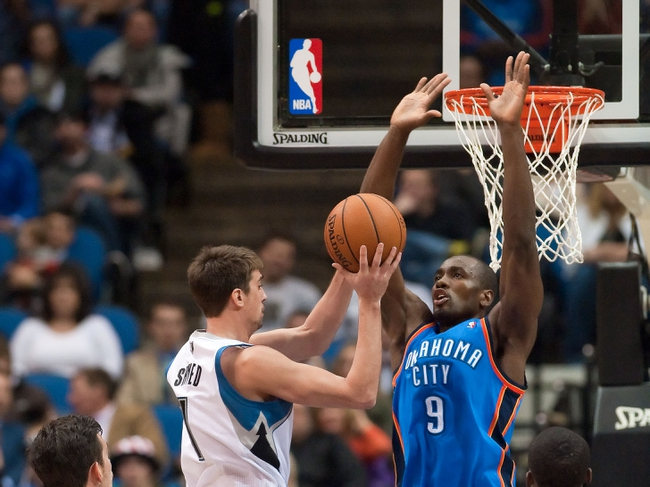 Nov 1, 2013; Minneapolis, MN, USA; Oklahoma City Thunder power forward Serge Ibaka (9) looks to block a shot by Minnesota Timberwolves point guard Alexey Shved (1) in the second quarter at Target Center. Timberwolves won 100-81. Mandatory Credit: Greg Smith-USA TODAY Sports