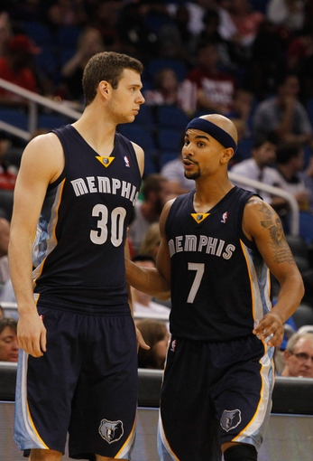 Oct 18, 2013; Orlando, FL, USA; Memphis Grizzlies power forward Jon Leuer (30) and point guard Jerryd Bayless (7) talk against the Orlando Magic during the second half at Amway Center. Memphis Grizzlies defeated the Orlando Magic 97-91. Mandatory Credit: Kim Klement-USA TODAY Sports