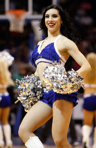 Nov 6, 2013; Orlando, FL, USA; Orlando Magic dancer cheers against the Los Angeles Clippers during the second half at Amway Center. Orlando Magic defeated the Los Angeles Clippers 98-90. Mandatory Credit: Kim Klement-USA TODAY Sports