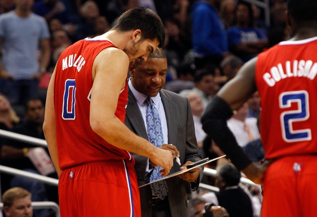 Nov 6, 2013; Orlando, FL, USA; Los Angeles Clippers head coach Doc Rivers talks with center Byron Mullens (0) against the Orlando Magic  during the second half at Amway Center. Orlando Magic defeated the Los Angeles Clippers 98-90. Mandatory Credit: Kim Klement-USA TODAY Sports