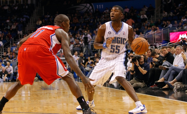 Nov 6, 2013; Orlando, FL, USA; Orlando Magic shooting guard E'Twaun Moore (55) drives to the basket as Los Angeles Clippers shooting guard Jamal Crawford (11) defends during the second half at Amway Center. Orlando Magic defeated the Los Angeles Clippers 98-90. Mandatory Credit: Kim Klement-USA TODAY Sports