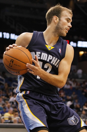 Oct 18, 2013; Orlando, FL, USA; Memphis Grizzlies shooting guard Nick Calathes (12) against the Orlando Magic during the second half at Amway Center. Memphis Grizzlies defeated the Orlando Magic 97-91. Mandatory Credit: Kim Klement-USA TODAY Sports