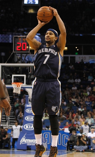 Oct 18, 2013; Orlando, FL, USA; Memphis Grizzlies point guard Jerryd Bayless (7) shoots against the Orlando Magic during the first half at Amway Center. Mandatory Credit: Kim Klement-USA TODAY Sports
