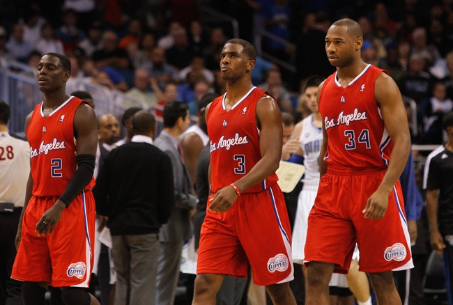 Nov 6, 2013; Orlando, FL, USA; Los Angeles Clippers point guard Darren Collison (2), point guard Chris Paul (3) and shooting guard Willie Green (34) walk to the bench against the Orlando Magic during the second half at Amway Center. Orlando Magic defeated the Los Angeles Clippers 98-90. Mandatory Credit: Kim Klement-USA TODAY Sports