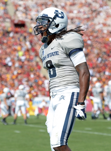 Sep 21, 2013; Los Angeles, CA, USA; Utah State Aggies receiver Travis Reynolds (8) celebrates during the game against the Southern California Trojans at the Los Angeles Memorial Coliseum. USC defeated Utah State 17-14. Mandatory Credit: Kirby Lee-USA TODAY Sports