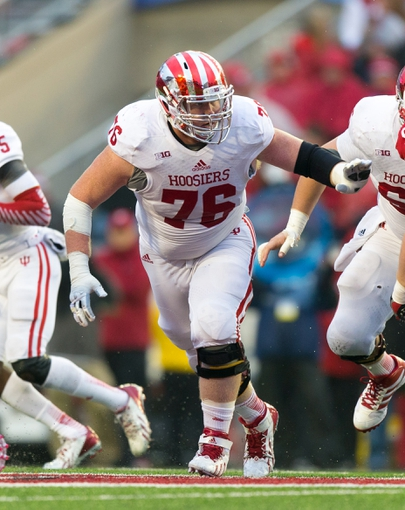 Nov 16, 2013; Madison, WI, USA; Indiana Hoosiers offensive lineman Cody Evers (76) during the game against the Wisconsin Badgers at Camp Randall Stadium. Wisconsin won 51-3.  Mandatory Credit: Jeff Hanisch-USA TODAY Sports