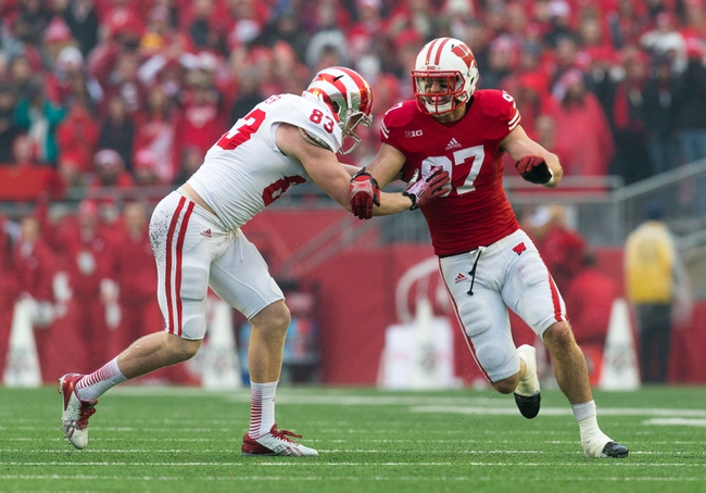 Nov 16, 2013; Madison, WI, USA; Wisconsin Badgers linebacker Brendan Kelly (97) is blocked by Indiana Hoosiers tight end Ted Bolser (83) during the game at Camp Randall Stadium. Wisconsin won 51-3.  Mandatory Credit: Jeff Hanisch-USA TODAY Sports
