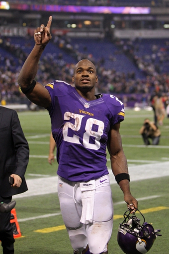 Nov 7, 2013; Minneapolis, MN, USA; Minnesota Vikings running back Adrian Peterson (28) against the Washington Redskins at Mall of America Field at H.H.H. Metrodome. The Vikings defeated the Redskins 34-27. Mandatory Credit: Brace Hemmelgarn-USA TODAY Sports