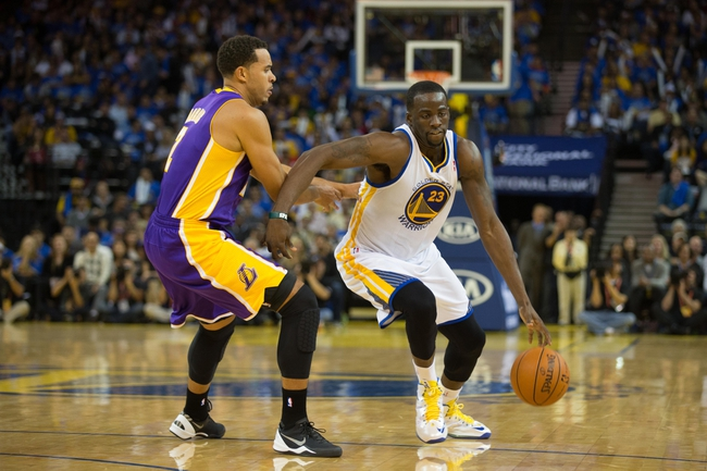 Oct 30, 2013; Oakland, CA, USA; Golden State Warriors small forward Draymond Green (23) drives in against Los Angeles Lakers small forward Elias Harris (2) during the fourth quarter at Oracle Arena. The Golden State Warriors defeated the Los Angeles Lakers 125-94. Mandatory Credit: Kelley L Cox-USA TODAY Sports
