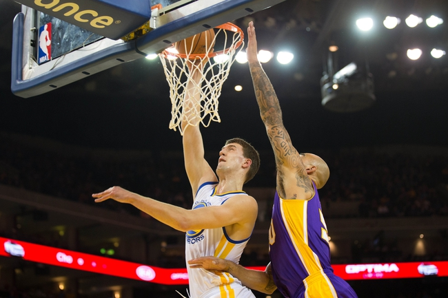 Oct 30, 2013; Oakland, CA, USA; Golden State Warriors center Ognjen Kuzmic (1) dunks the ball against Los Angeles Lakers center Robert Sacre (50) during the fourth quarter at Oracle Arena. The Golden State Warriors defeated the Los Angeles Lakers 125-94. Mandatory Credit: Kelley L Cox-USA TODAY Sports