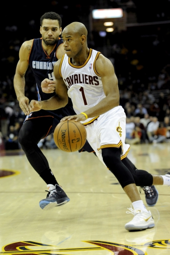 Nov 15, 2013; Cleveland, OH, USA; Cleveland Cavaliers point guard Jarrett Jack (1) drives on Charlotte Bobcats shooting guard Jeff Taylor (44) at Quicken Loans Arena. Mandatory Credit: Ken Blaze-USA TODAY Sports