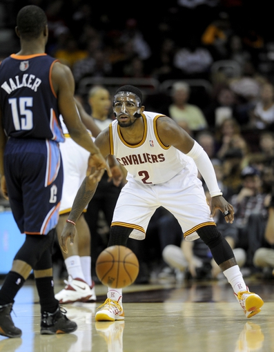 Nov 15, 2013; Cleveland, OH, USA; Cleveland Cavaliers point guard Kyrie Irving (2) and Charlotte Bobcats point guard Kemba Walker (15) at Quicken Loans Arena. Mandatory Credit: Ken Blaze-USA TODAY Sports