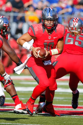 Nov 16, 2013; Piscataway, NJ, USA;  Rutgers Scarlet Knights quarterback Gary Nova (10) during the first half against the Cincinnati Bearcats at High Points Solutions Stadium. Mandatory Credit: Jim O'Connor-USA TODAY Sports