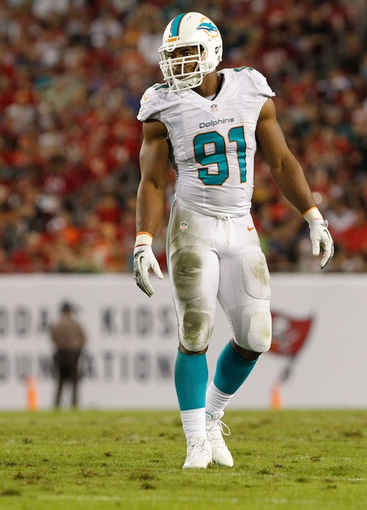 Nov 11, 2013; Tampa, FL, USA; Miami Dolphins defensive end Cameron Wake (91) against the Tampa Bay Buccaneers during the second half at Raymond James Stadium. Mandatory Credit: Kim Klement-USA TODAY Sports