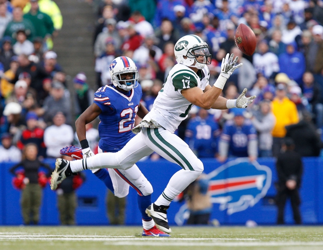 Nov 17, 2013; Orchard Park, NY, USA; New York Jets wide receiver Vidal Hazelton (17) catches a pass while being covered by Buffalo Bills cornerback Leodis McKelvin (21) during the second half at Ralph Wilson Stadium. Bills beat the Jets 37-14. Mandatory Credit: Kevin Hoffman-USA TODAY Sports
