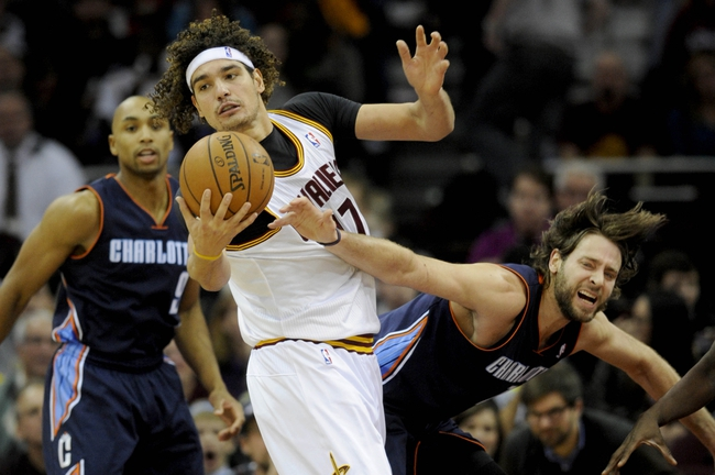 Nov 15, 2013; Cleveland, OH, USA; Cleveland Cavaliers center Anderson Varejao (17) grabs a rebound from Charlotte Bobcats power forward Josh McRoberts (11) at Quicken Loans Arena. Mandatory Credit: Ken Blaze-USA TODAY Sports