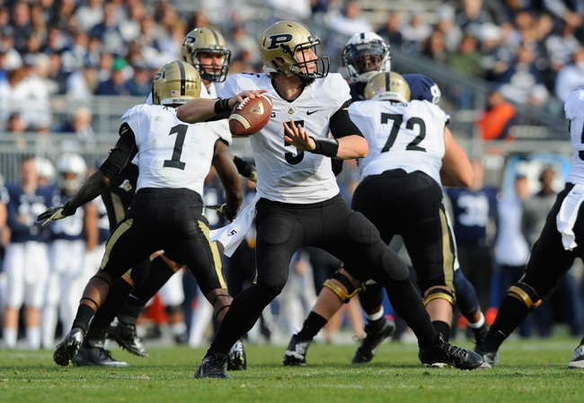 Nov 16, 2013; University Park, PA, USA; Purdue Boilermakers quarterback Danny Etling (5) drops back to pass against the Penn State Nittany Lions during the fourth quarter at Beaver Stadium.  Penn State defeated Purdue  45-21.  Mandatory Credit: Rich Barnes-USA TODAY Sports