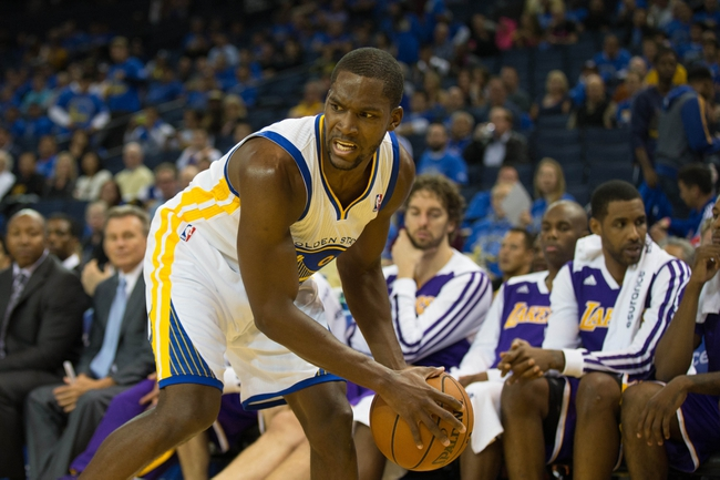Oct 30, 2013; Oakland, CA, USA; Golden State Warriors point guard Toney Douglas (0) controls the ball against the Los Angeles Lakers during the fourth quarter at Oracle Arena. The Golden State Warriors defeated the Los Angeles Lakers 125-94. Mandatory Credit: Kelley L Cox-USA TODAY Sports