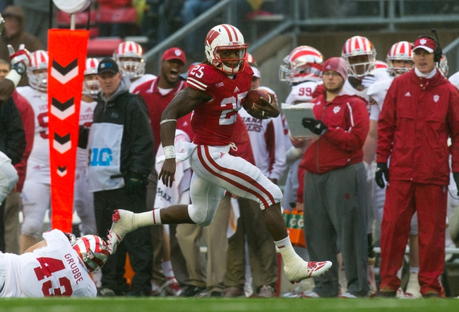 Nov 16, 2013; Madison, WI, USA; Wisconsin Badgers running back Melvin Gordon (25) during the game against the Indiana Hoosiers at Camp Randall Stadium. Wisconsin won 51-3.  Mandatory Credit: Jeff Hanisch-USA TODAY Sports