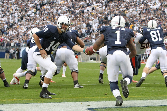 Nov 2, 2013; University Park, PA, USA; Penn State Nittany Lions quarterback Christian Hackenberg (14) attempts to hand the ball off to running back Bill Belton (1) during the fourth quarter against the Illinois Fighting Illini at Beaver Stadium. Penn State defeated Illinois 24-17. Mandatory Credit: Matthew O'Haren-USA TODAY Sports
